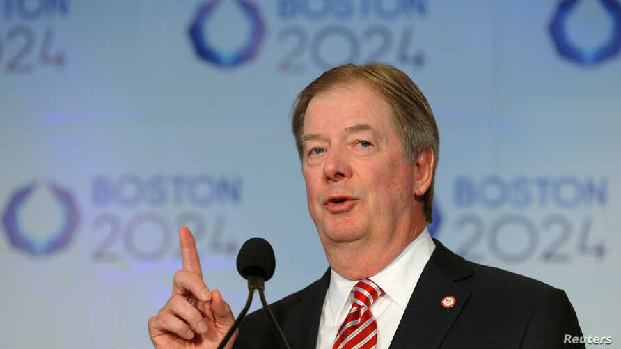 FILE - U.S. Olympic Committee chairman Larry Probst speaks at a news conference in Boston, Massachusetts, Jan. 9, 2015