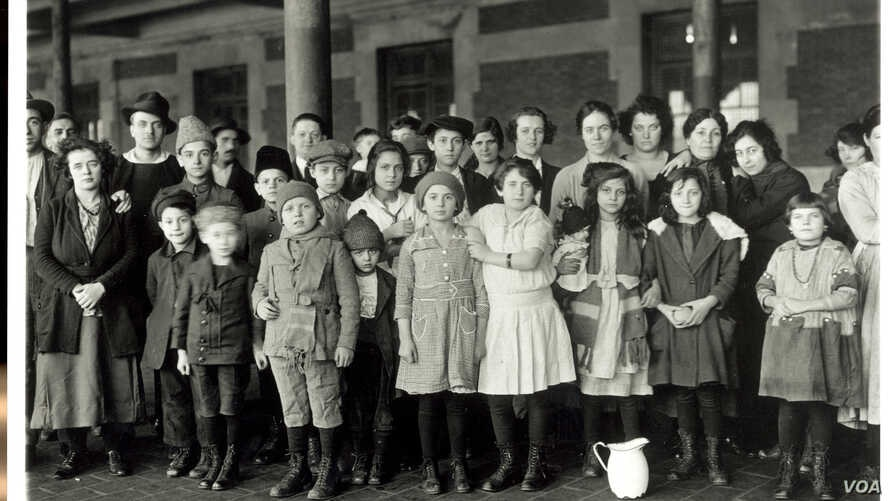 Immigrant children are part of this group photographed at Ellis Island in New York, about 1908.
