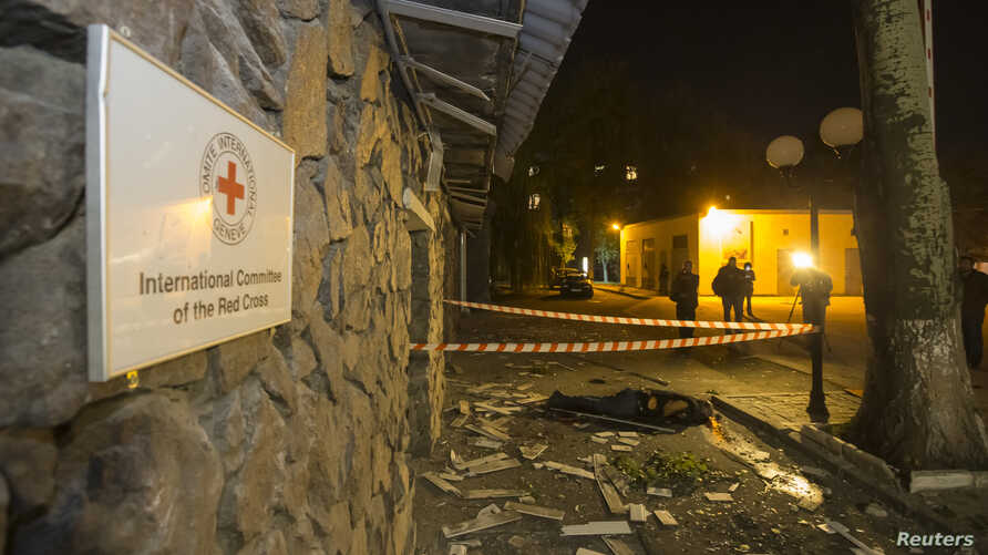 The body of a victim killed by recent shelling lies near the Red Cross office in Donetsk, eastern Ukraine, Oct. 2, 2014.