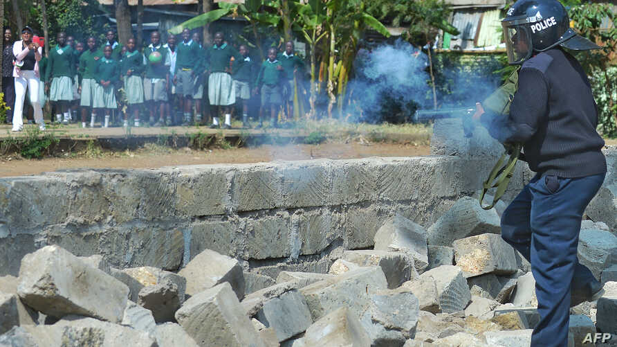 Police tear gas children from the Langata Road Primary School Jan. 19, 2015 in Nairobi.