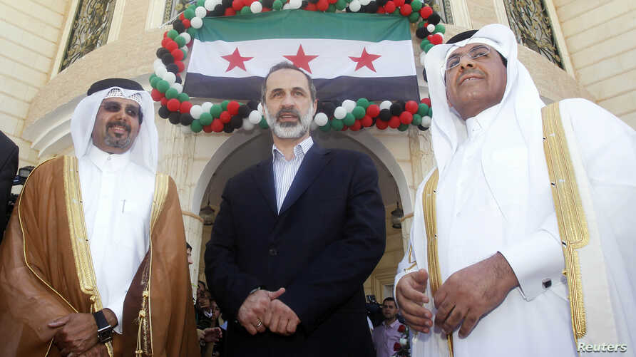 Mouaz al-Khatib (center) keynoted the Syrian opposition's