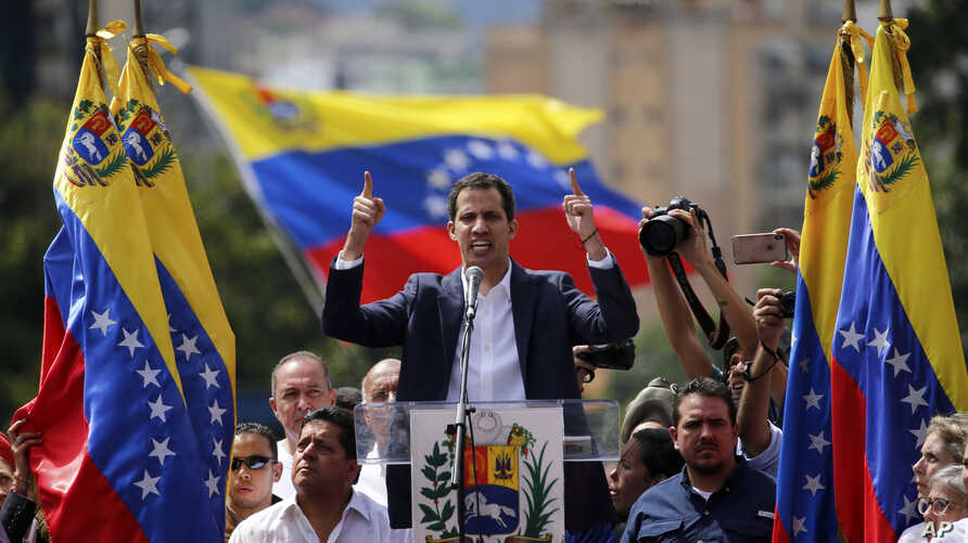 Juan Guaido, head of Venezuela's opposition-run congress, declares himself interim president of the nation until elections can be held during a rally demanding President Nicolas Maduro's resignation in Caracas, Venezuela, Jan. 23, 2019.