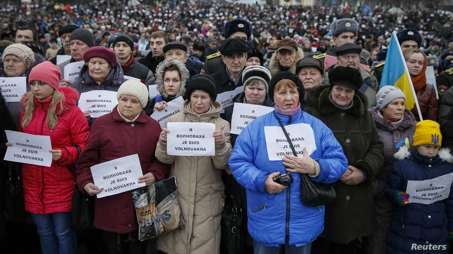 Scores of people are seen taking part in a peace march in Kyiv, Ukaine, Jan. 18, 2015.