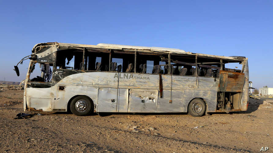A bus damaged after a crash carrying Palestinian pilgrims en route to Saudi Arabia, on the outskirts of Maan, Jordan, Thursday, March 17, 2016.