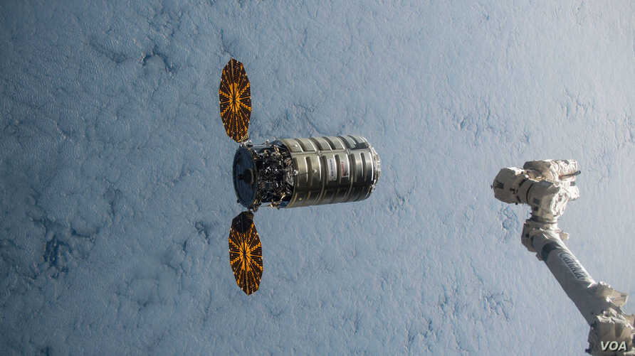 rbital ATK's Cygnus cargo craft approaches the International Space Station on Dec. 9, 2015.