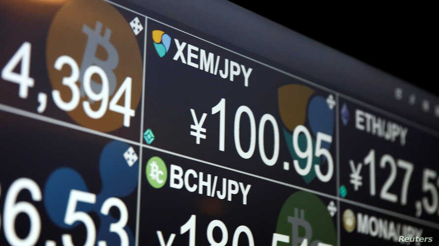 A monitor shows various cryptocurrencies' exchange rates against Japanese Yen including NEM coin (middle in the top) at 'nem bar', where customers can pay with NEM coins, in Tokyo, Japan Jan. 29, 2018.