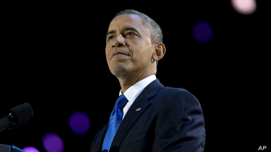 President Barack Obama pauses as he speaks at the election night party at McCormick Place in Chicago, early Wednesday, Nov. 7, 2012.