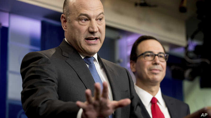 National Economic Director Gary Cohn, left, accompanied by Treasury Secretary Steve Mnuchin, speaks in the briefing room of the White House, in Washington, April 26, 2017, where they discussed President Donald Trump tax proposals.