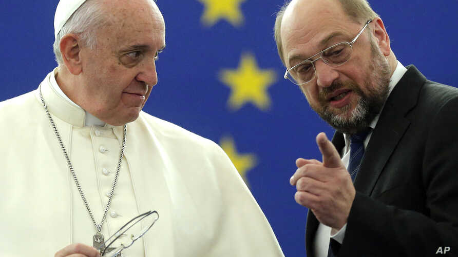 Pope Francis, left, listens to E.U. Parliament President Martin Schulz at the European Parliament in Strasbourg, in eastern France, Nov. 25, 2014.