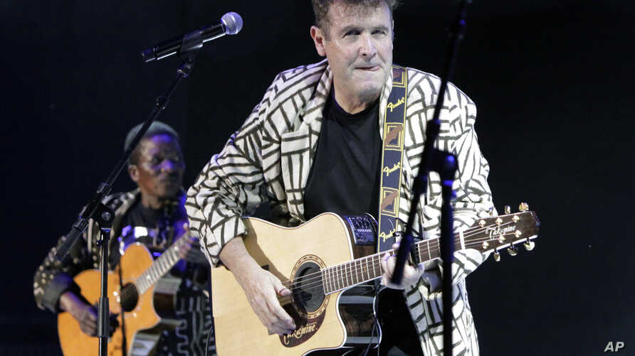 FILE - In this Nov. 6, 2010 file photo, South African musician Johnny Clegg performs during a concert in Johannesburg. Clegg, who blended Western pop and Zulu rhythms in multi-racial bands during white minority rule, will embark this year on his last