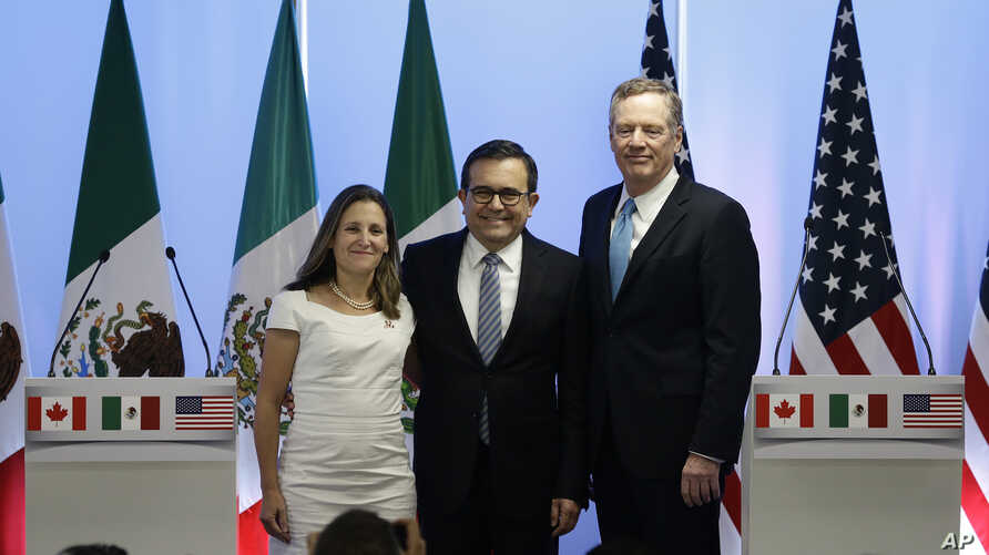 Canadian Foreign Affairs Minister Chrystia Freeland, from left, Mexico's Secretary of Economy Ildefonso Guajardo Villarreal, and U.S. Trade Representative Robert Lighthizer, pose at a press conference regarding the second round of NAFTA renegotiation