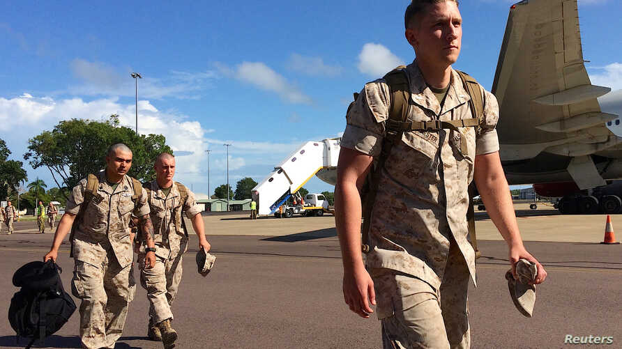 U.S. Marines walk after disembarking a plane after they arrived for the annual Marines' deployment at Darwin in northern Australia, April 18, 2017.