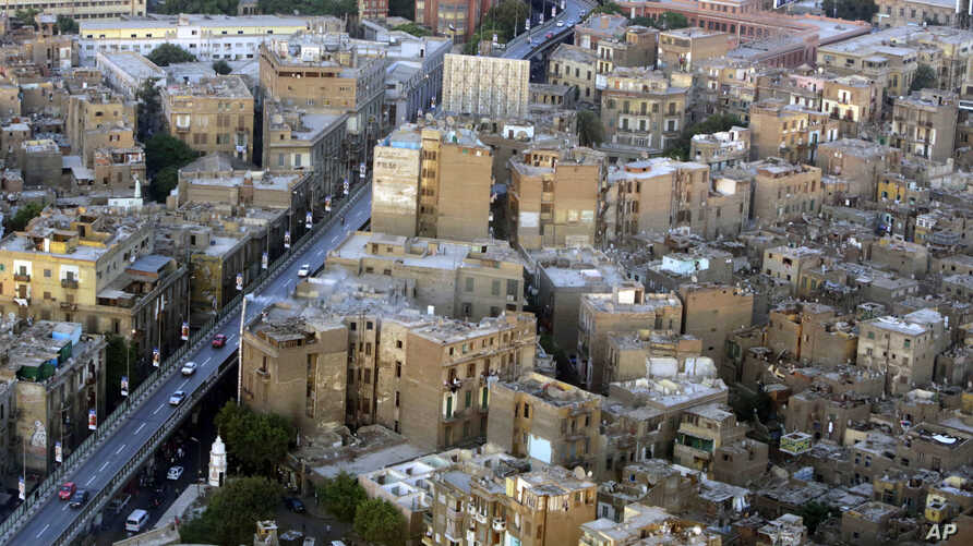FILE - This July 18, 2014, photo shows buildings, to the right of the bridge, that are to be demolished as part of a redevelopment plan in the Maspero neighborhood of Cairo, Egypt. Egyptian authorities are demolishing the 19th-century neighborhood to