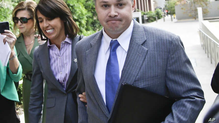 FILE - John Beliveau II, right, is accompanied by attorney Gretchen von Helms, left, at the federal courthouse in San Diego, California, Dec. 17, 2013. Beliveau was sentenced to 12 years in prison on Friday for his role in corruption against the U.S.