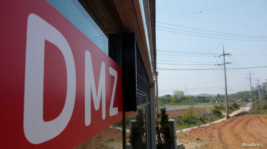 A sign advertising properties within and along the demilitarized zone (DMZ) that separates the two Koreas, is seen at a real estate agency in Munsan, South Korea, May 10, 2018.