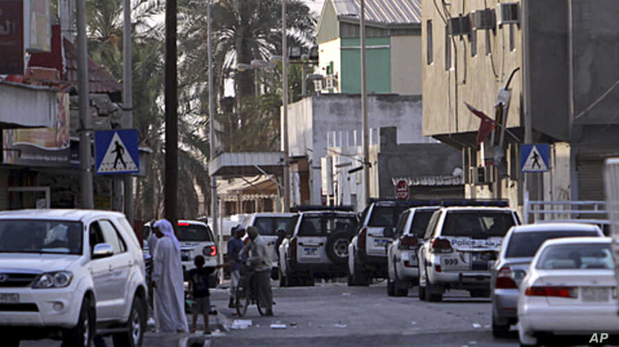 Riot police vehicles move through the streets of the western Shiite Muslim village of Malkiya, Bahrain, June 1, 2011