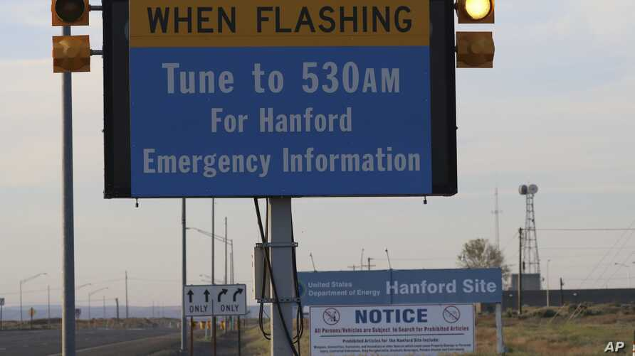An emergency sign flashes by the Hanford Nuclear Reservation, May 9, 2017, in Richland, Wash. A portion of an underground tunnel containing rail cars filled with radioactive waste collapsed at a sprawling storage facility in a remote area of Washingt
