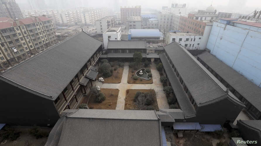 An unfinished residence which belongs to former People's Liberation Army (PLA) General Gu Junshan is pictured in Puyang, Henan province, January 19, 2014.
