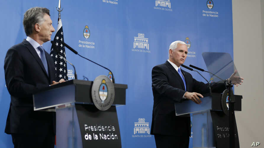 U.S. Vice President Mike Pence, right, and Argentina's President Mauricio Macri attend a news conference at the government residence in Buenos Aires, Argentina, Aug. 15, 2017.