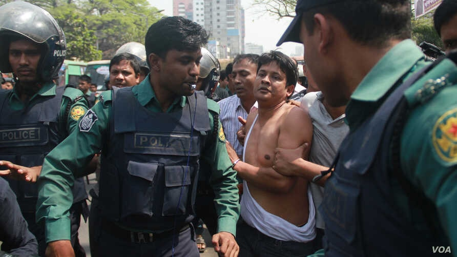 An opposition BNP activist is being arrested by policemen in Dhaka. In 2018, thousands of opposition leaders and activists were arrested in Bangladesh on allegedly trumped up cases of political violence.