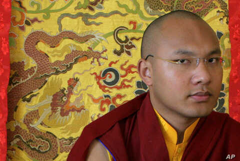 Karmapa Lama, the third highest ranking Lama, pauses during an interview with Reuters in the northern Indian hill town of Dharamsala March 2, 2009.