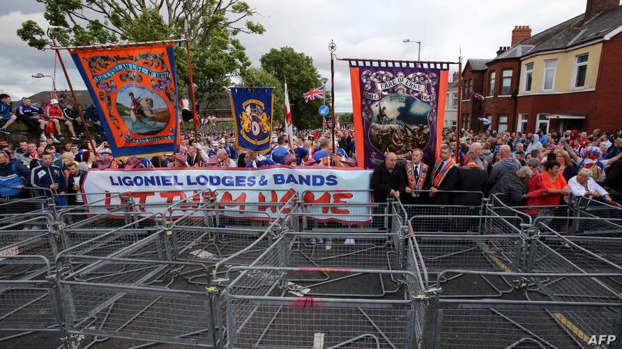 BRITAIN-NIRELAND-POLITICS-MARCHES  Loyalist supporters confront police at Woodvale Road, after a loyalist parade was banned from marching past the Nationalist Ardoyne shops in north Belfast, Northern Ireland on July 13, 2015