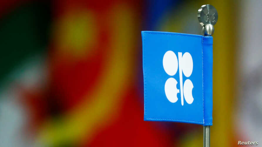 FILE - A flag with the Organization of the Petroleum Exporting Countries (OPEC) logo is seen during a meeting of the Organization of the Petroleum Exporting Countries (OPEC) and non-OPEC producing countries in Vienna, Austria.