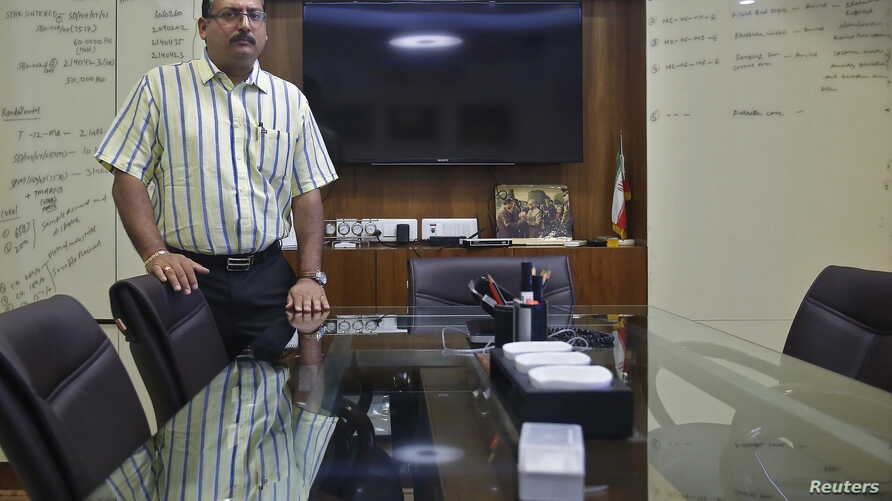 FILE - Indian businessman Pankaj Bansal poses for a picture inside his office in New Delhi, India, July 8, 2015.