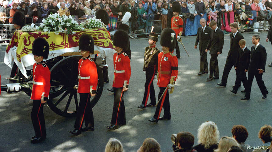 Guardsmen escort the coffin of Diana, Princess of Wales draped in the Royal Standard, as the cortege passes through crowds gathered along Whitehall. Walking behind them are the Duke of Edinburgh, Prince William, the Earl of Spencer, Prince Harry and