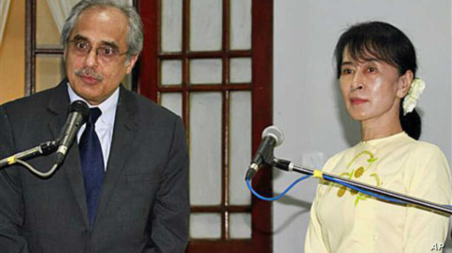 UN special adviser Vijay Nambiar (L) speaks during a news conference following his meeting with Burma's pro-democracy leader Aung San Suu Kyi, at her home in Rangoon, Burma, February 16, 2012.