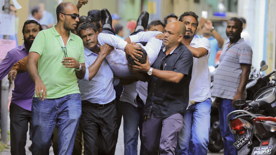 Maldivian lawmaker Faisal Naseem who was injured in clashes with police is rushed to a hospital in Male, Maldives, July 24, 2017. The Maldivian opposition says the military locked down parliament on the orders of the country's president in a bid to p