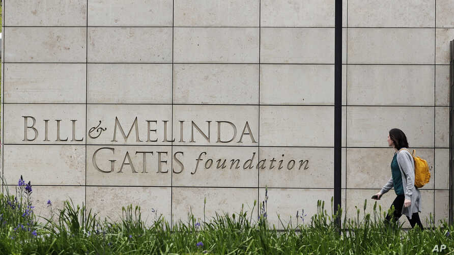 FILE - A person walks by the headquarters of the Bill and Melinda Gates Foundation in Seattle, Washington, April 27, 2018.