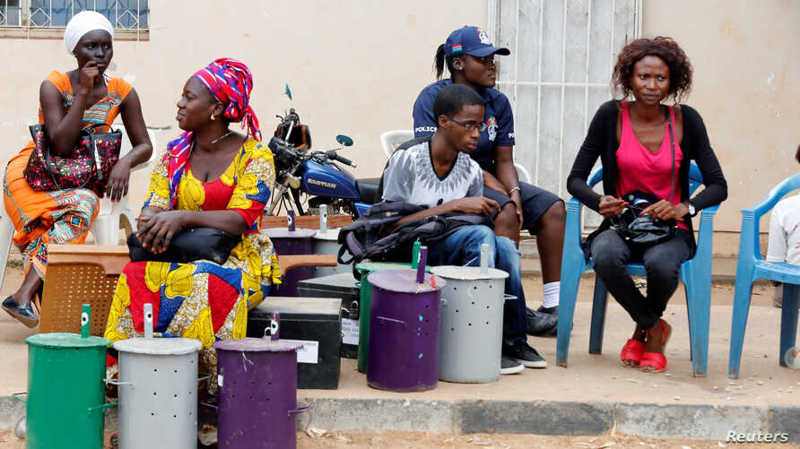 Polling officials wait at the local IEC (Independent Electoral Commission) headquarters to distribute the ballot boxes to the polling stations, in Serekunda, Gambia, Nov. 29, 2016.