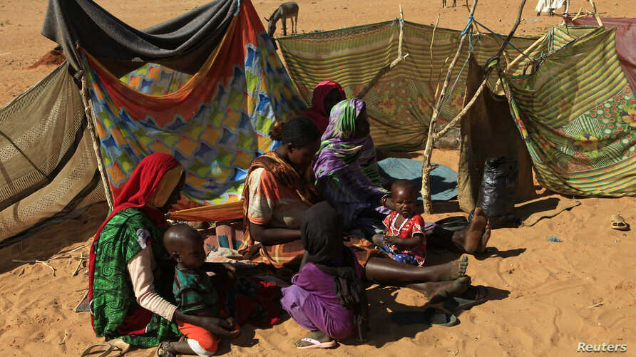 FILE - People rest next to shelters at the Zamzam camp for internally displaced persons near El Fasher in North Darfur, February 4, 2015.