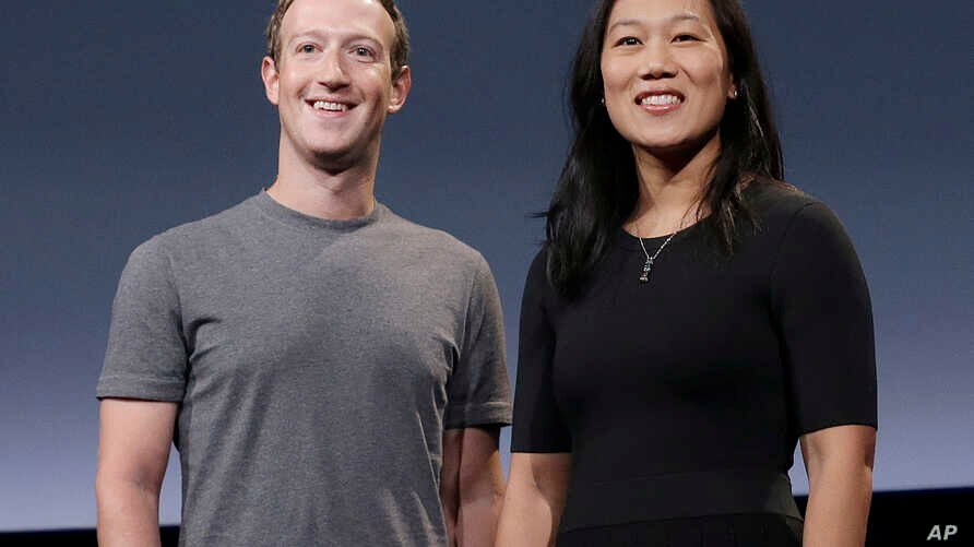 FILE -  Facebook CEO Mark Zuckerberg and his wife, Priscilla Chan, smile as they prepare for a speech in San Francisco.
