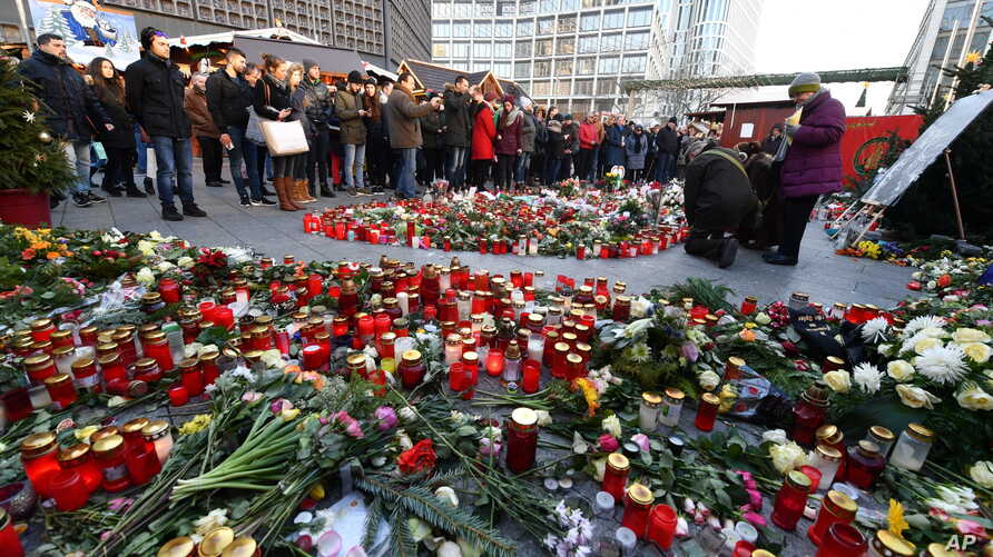 Candles and flowers to commemorate the victims of the terrorist attack on 19 December 2016 have been placed at the Christmas market near the Memorial Church in Berlin, Germany, Saturday, Dec. 31, 2016.