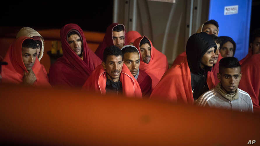 In this photo taken Oct. 27, 2018, migrants arrive at the port of San Roque, southern Spain, after being rescued by Spain's Maritime Rescue Service in the Strait of Gibraltar.