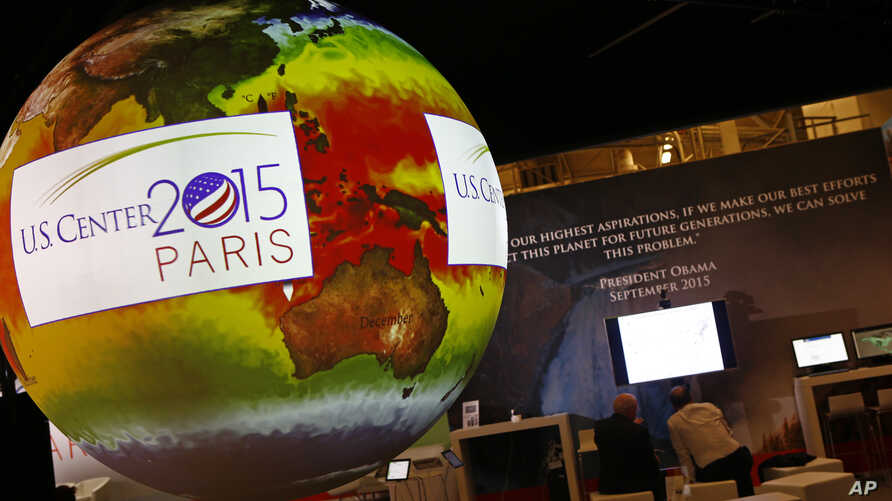 A giant globe displays a video animation during a conference about Antarctic mass change at the U.S. Pavillon during the COP21, United Nations Climate Change Conference, in Le Bourget, outside Paris, Tuesday, Dec. 1, 2015.
