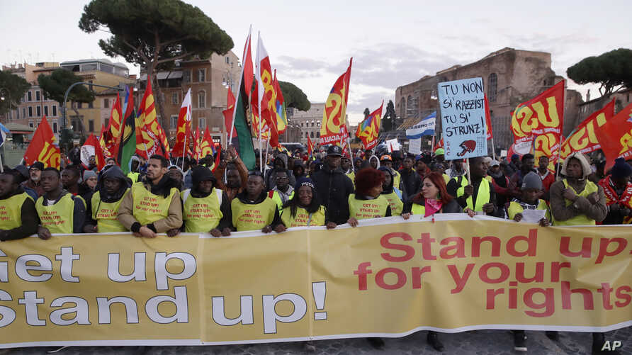 "Demonstrators in Rome shout ""Get Up! Stand Up! Stand Up fo"