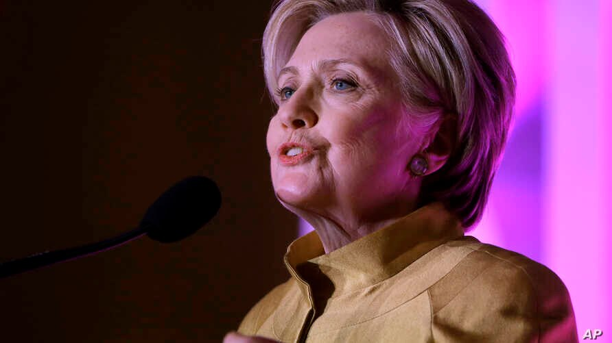 Former Secretary of State Hillary Clinton speaks during a fundraising event for Big Sister Association of Greater Boston, Dec. 5, 2017, in Boston. Clinton was presented with the organization's Believe in Girls award during the event.