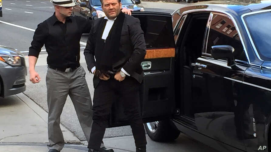 Amedeo Dicarlo, lawyer for Karim Baratov, arrives at the courthouse in a chauffeured Rolls Royce in Hamilton, Ontario, Canada, April 5, 2017.