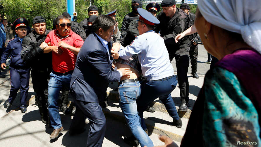 Riot police officers detain demonstrators during a protest against President Nursultan Nazarbayev's government and the land reform it has proposed, in Almaty, Kazakhstan, May 21, 2016.