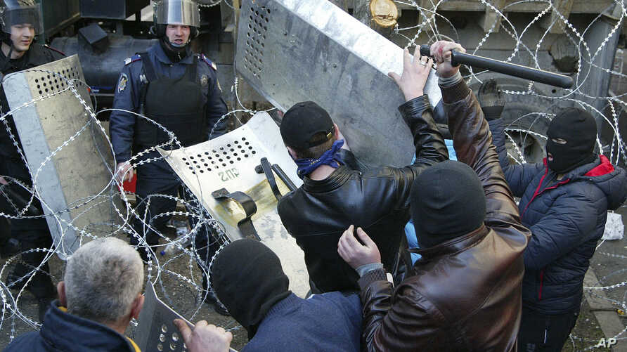 People clash with police at the regional administration building in Donetsk, Ukraine, April 6, 2014.