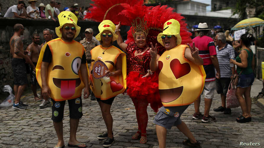 "Revellers take part in the annual block party known as ""Carmelitas,"" during carnival festivities in Rio de Janeiro, March 1, 2019."