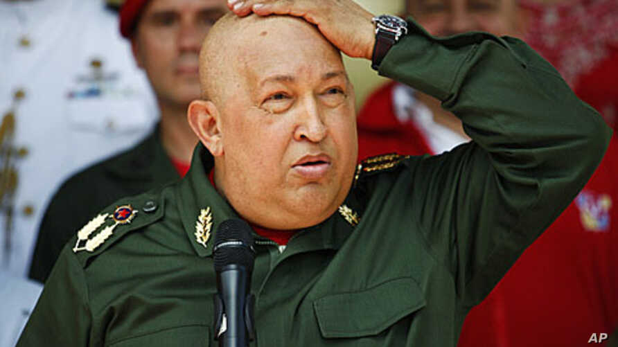 Venezuela's President Hugo Chavez touches his head as he speaks to the media in Caracas September 17, 2011, before heading to Cuba for more chemotherapy.