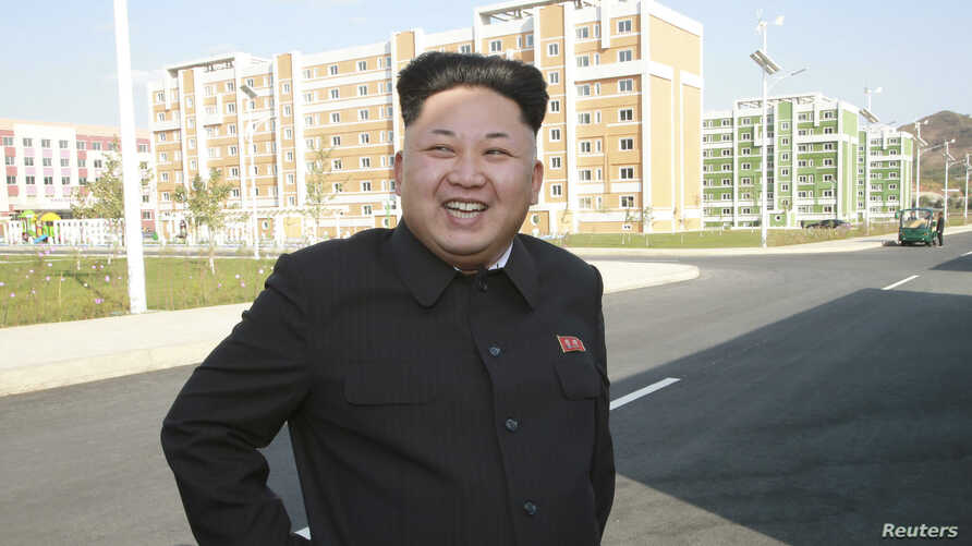 North Korean leader Kim Jong Un gives field guidance to the newly built Wisong Scientists Residential District in this undated photo released by North Korea's Korean Central News Agency (KCNA) in Pyongyang October 14, 2014. Kim, shown using a cane fo