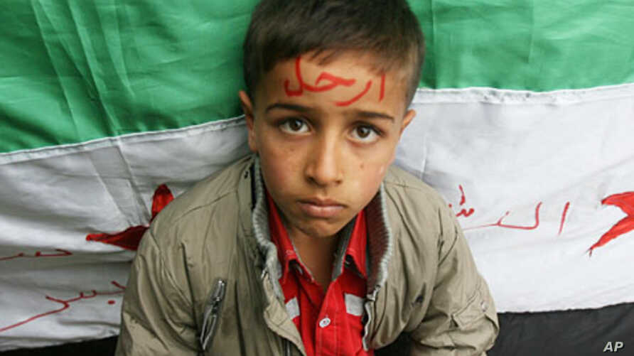 Syrian refugee with word 'Go' on his forehead, in reference to President Bashar al-Assad, northern Lebanon, Nov 12, 2011.