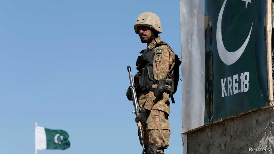 A Pakistani soldier stands guard at the Angoor Adda outpost along Pakistan's border with Afghanistan, in South Waziristan, Pakistan Oct. 18, 2017.