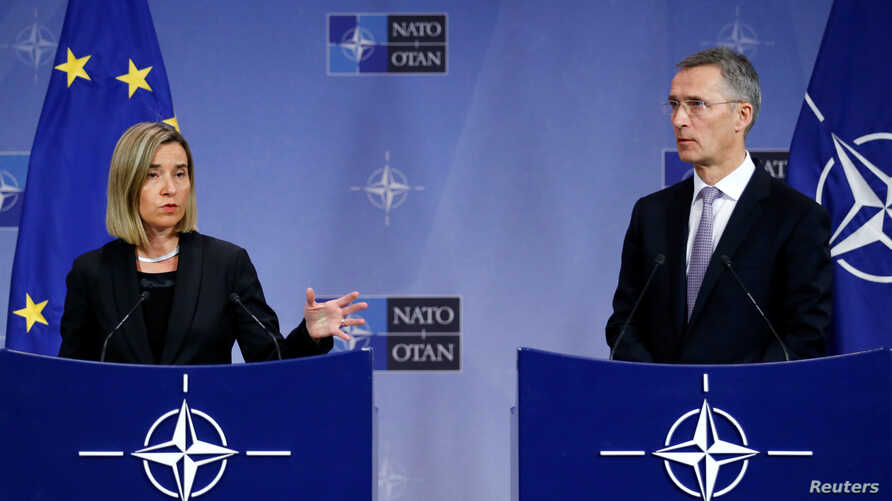 European Union foreign policy chief Federica Mogherini and NATO Secretary-General Jens Stoltenberg address a joint news conference during a NATO foreign ministers meeting at the Alliance headquarters in Brussels, Belgium, Dec. 6, 2016.
