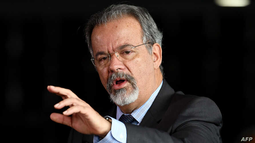 FILE - Public Security Minister Raul Jungmann, pictured delivering a speech in Brasilia on March 2, 2018, said on May 17, 2018 that those arrested in a major push to stop online child pornography faced charges of sexual exploitation of children and a
